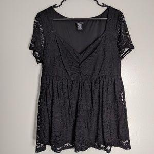 Torrid, size 0 stretchy black lace shirt